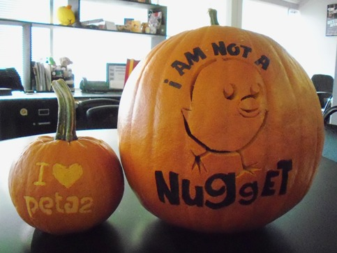 "jack o'lanterns made with peta2 stencils ""i am not a nugget and ""i heart peta2"""