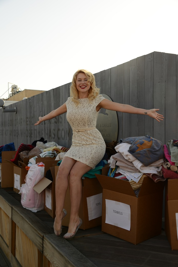 Renee Olstead celebrates collecting so many donations for Los Angeles Animal Services!