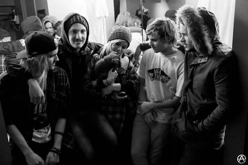 Tonight Alive posses with stray puppy, Baby, photo by Adam Elmakias