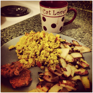 I cooked this great vegan breakfast for my roommate. Pictured (left to right): vegan sausage, scrambled tofu, coffee, and home fries.