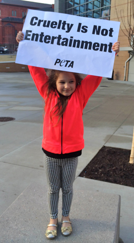 kid protesting the circus