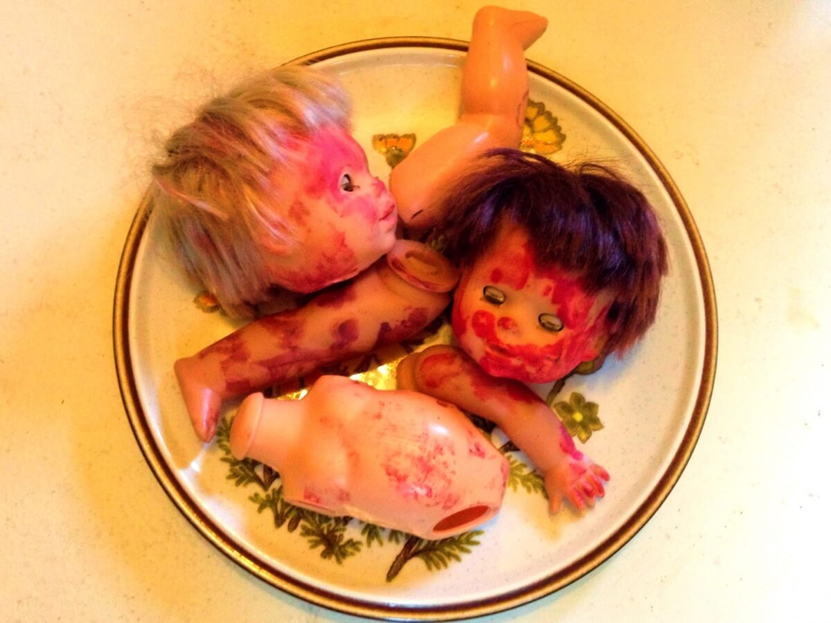 dead baby dolls on a plate