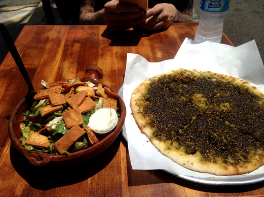 Toum (the white sauce in the container) is a traditional Lebanese garlic and lemon sauce that's often served alongside salad or as a dipping sauce.