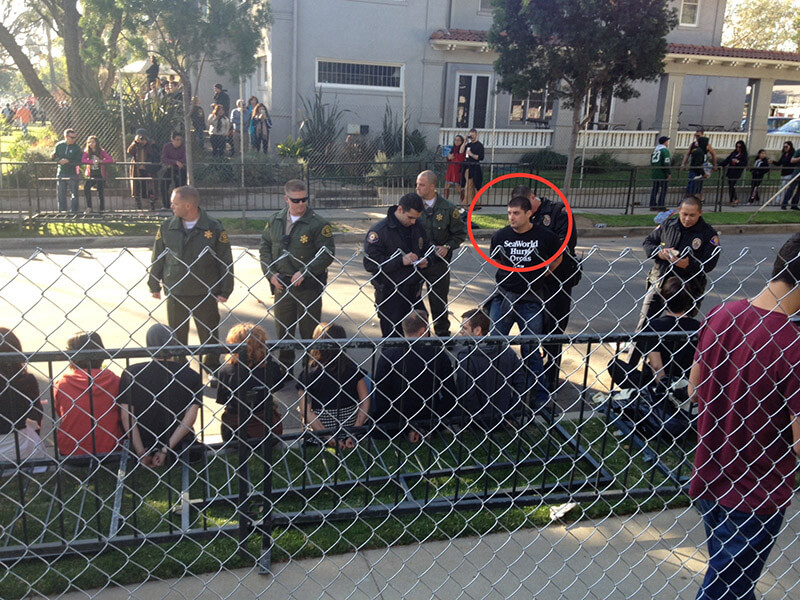 """""""Thomas Jones"""" arrested at protest."""